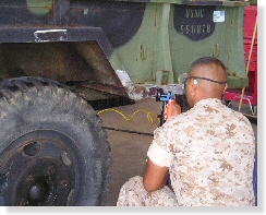 Image of a Marine working on a vehicle